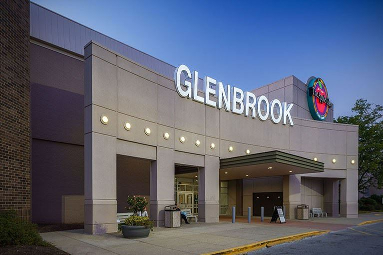 A large Glenbrook sign is placed on one of the Glenbrook Square's entrances on a sunny day.